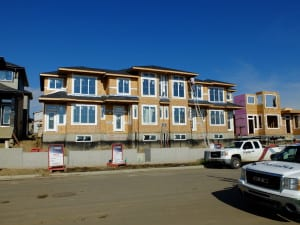 Street-oriented townhomes under construction! Garages are in the rear on a lane.